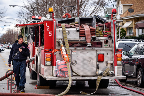 back of fire engine with hose