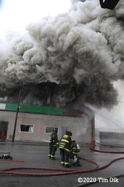 massive smoke from commercial building fire