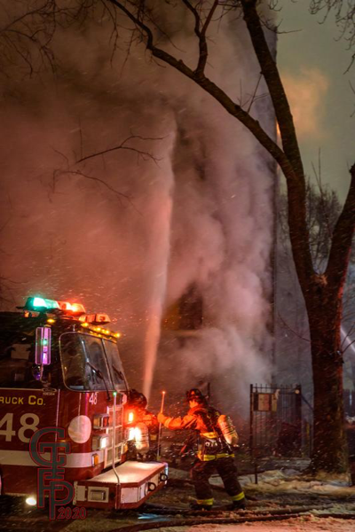 Chicago Firefighters battle a fire in the winter