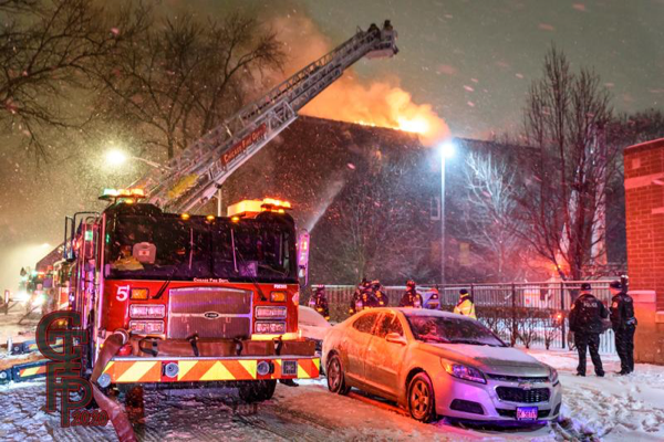 E-ONE tower ladder battles a fire