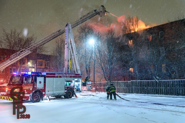 Firefighters battle building fire in blizzard