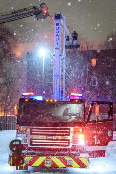 Firefighters battle building fire in blizzard