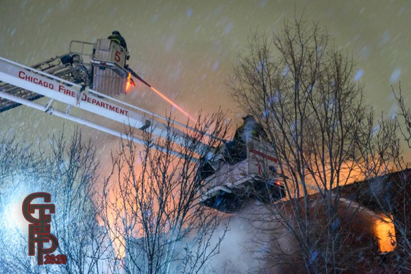 two elevated master streams battle a fire