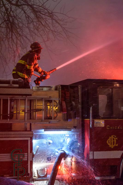 Firefighter with deck gun in blowing snow