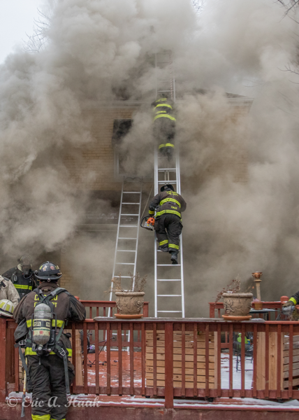 massive smoke engulfs Firefighters on ladder