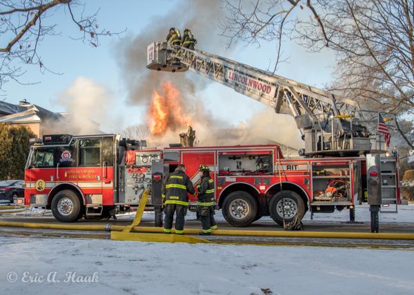 Pierce tower ladder battling a fire