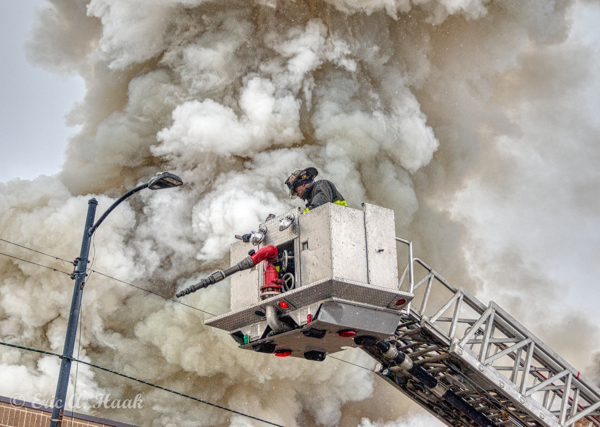 master stream from e-ONE tower ladder at fire