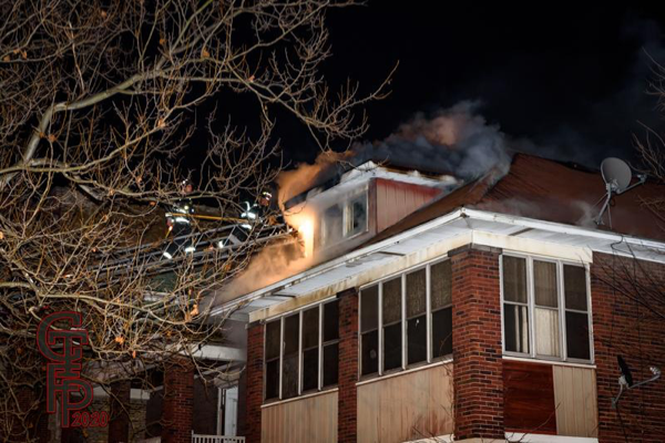 fire through the roof of an attic in Harvey IL