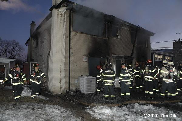 Firefighters at scene of a house fire