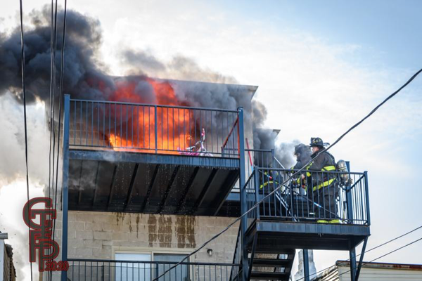 smoke and flames from top floor apartment
