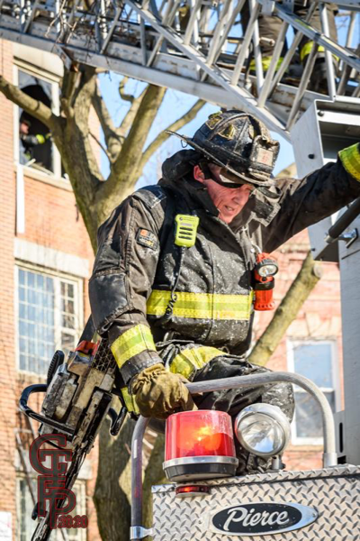 Firefighter in full PPE with saw