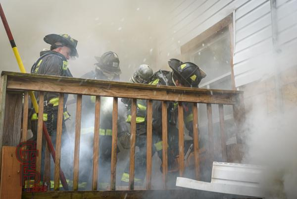 Firefighters in heavy smoke