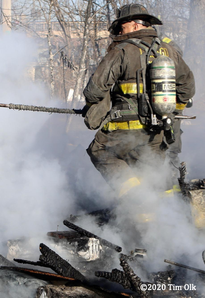 Chicago Firefighter in PPE with smoke