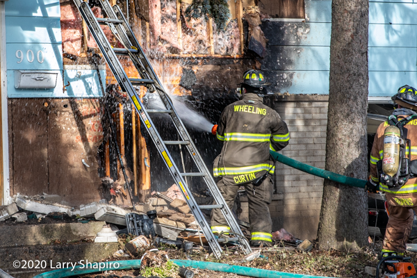 Firefighter washes down hot spots