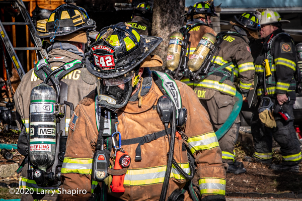 dramatic photo of Firefighter in full PPE