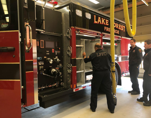 Firefighters examine new fire truck