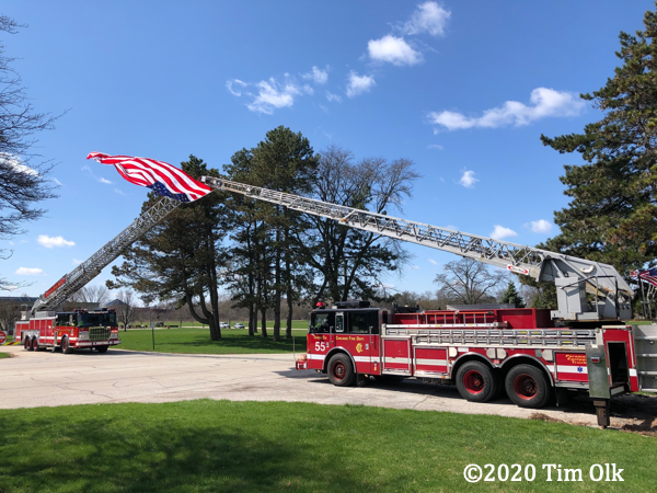 Chicago FD ladder trucks supporting US flag