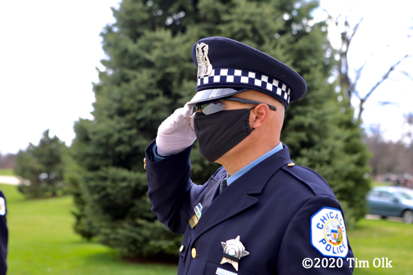 Chicago police officer saluting with protective mask on