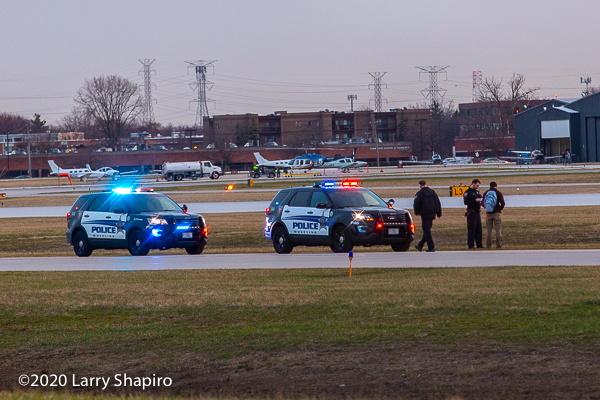 Wheeling police units on the runway at Chicago Executive Airport