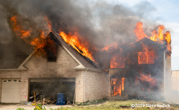 house engulfed in fire