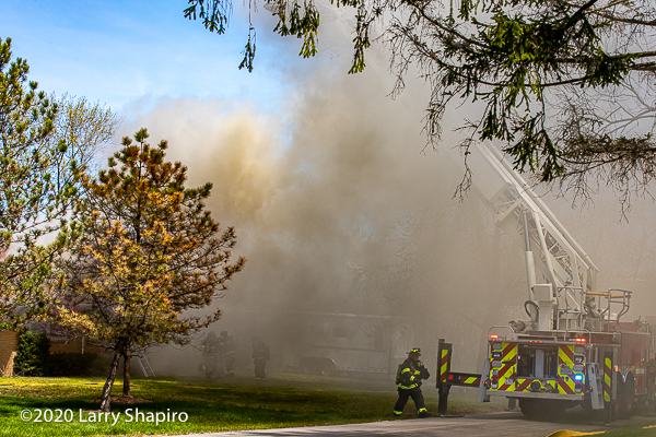 heavy smoke billows from house fire