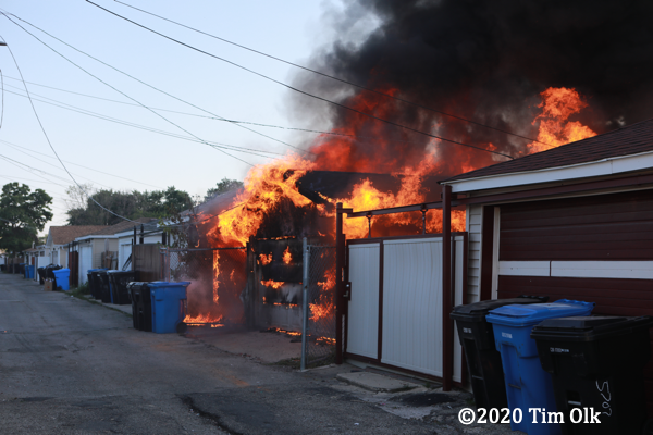 flames engulf alley garages