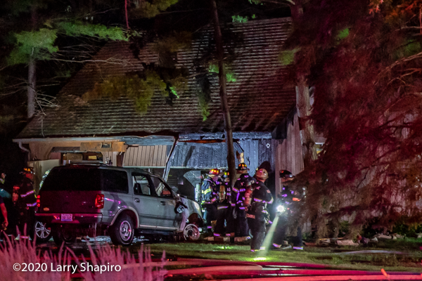 car fire extends to house