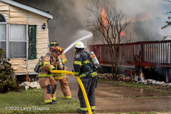 "Firefighters use a 2 1/2"" hand line to battle trailer fire"
