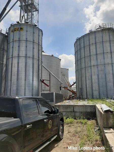 aerial ladder stretches to grain bin