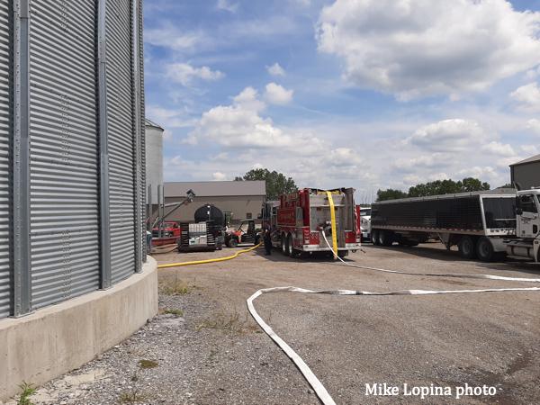 Beecher FPD firefighters on the scene of a grain bin fire