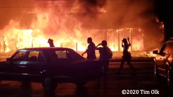 storefront engulfed by flames during Kenosha riots