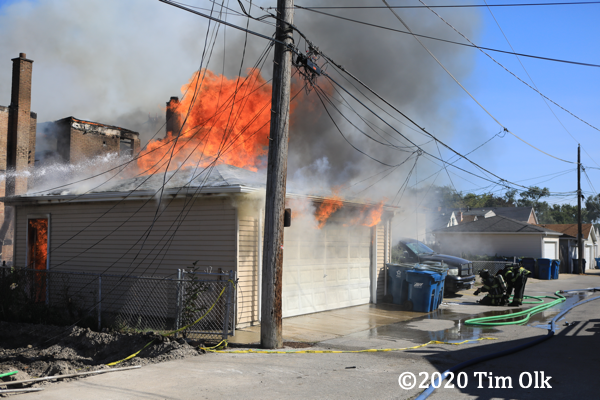flames from detached garage on fire
