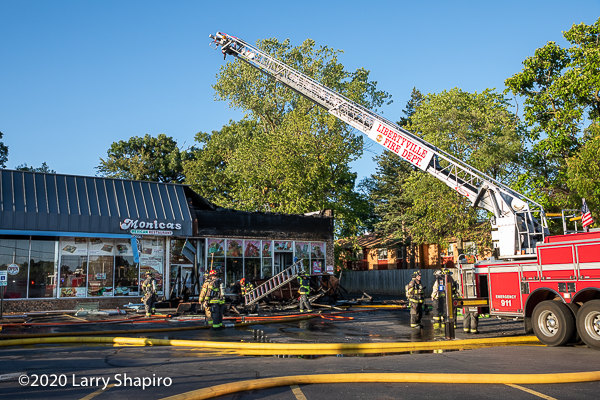 aftermath of a fire in a strip mall
