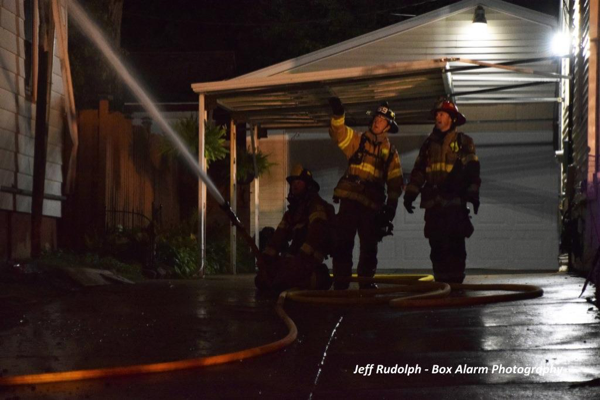 Firefighters with hose line at night