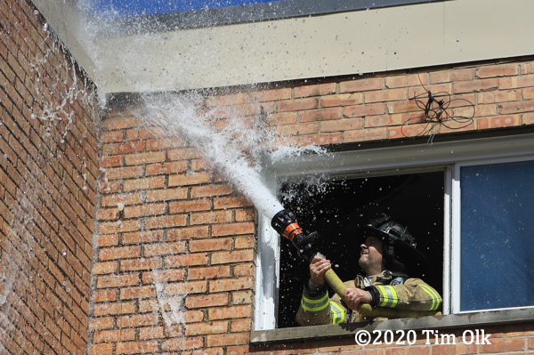 Firefighters at t he scene of a small fire in an apartment building in Belvidere, IL 9-2-20