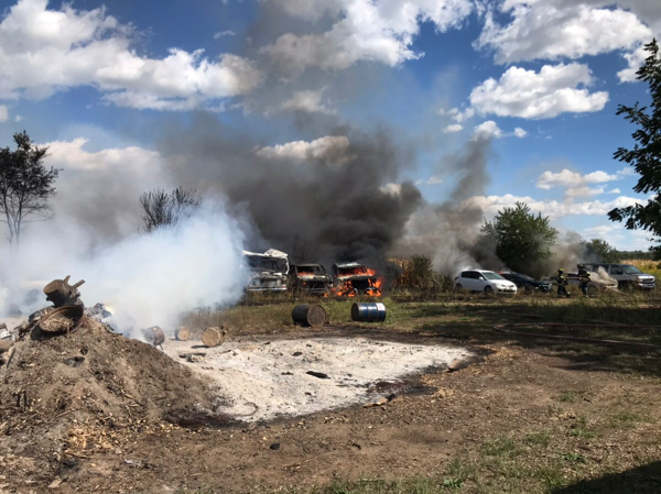 multiple cars on fire in a field