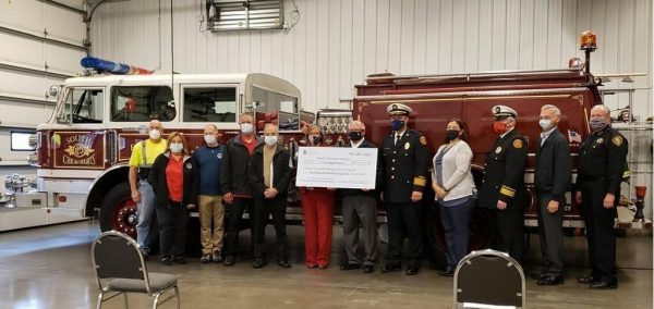 politicians and Firefighters with ceremonial check