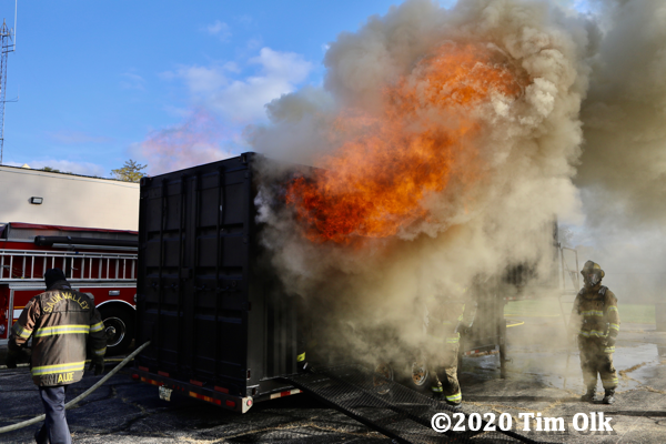 heavy smoke and flames from flashover fire training prop
