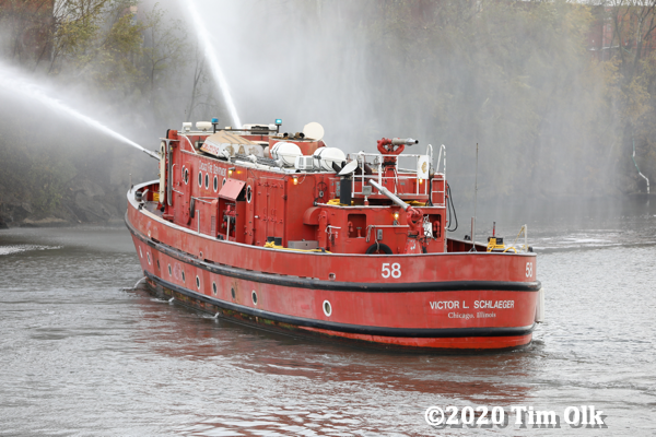 Chicago fire boat assisting with suburban junkyard fire