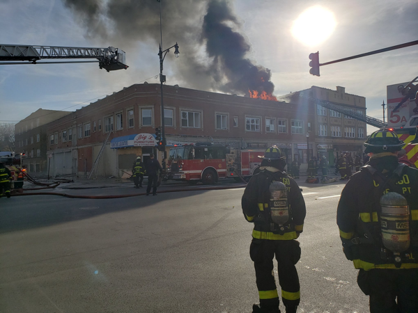 flames through roof of commercial building in Chicago