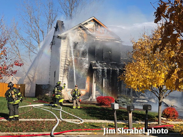 Firefighters use foam on house fire