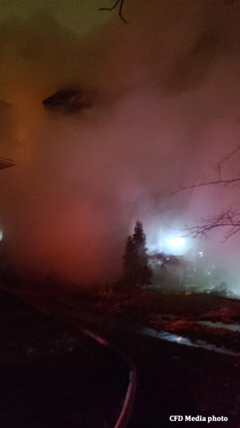 smoke obscures a house on fire at night