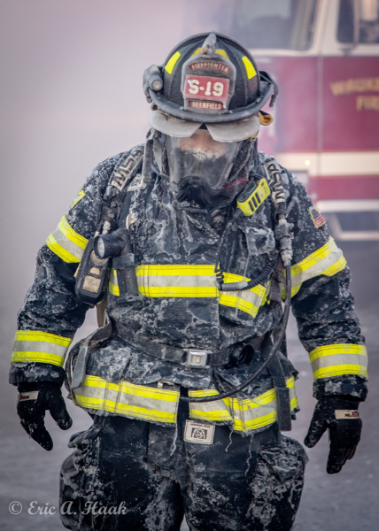 Deerfield Firefighter encrusted with ice at winter fire