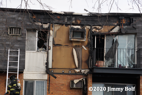 damage to apartment with mansard roof