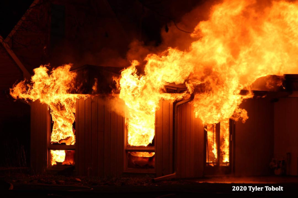 fire engulfs a house at night