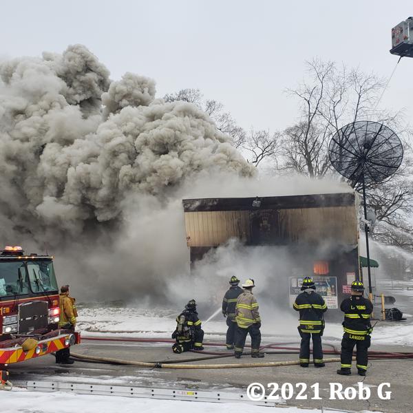 Firefighters battle fire in a pub
