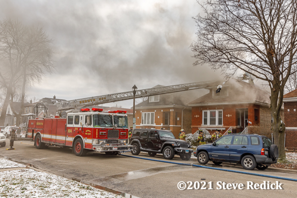 Seagrave aerial ladder at house fire