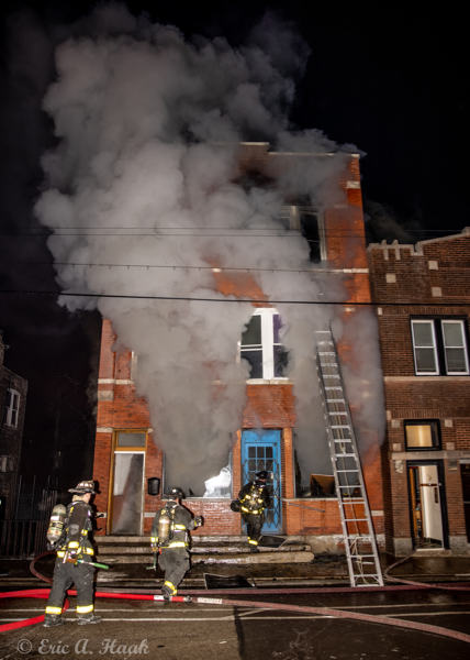 Chicago Firefighters battle a fire at night