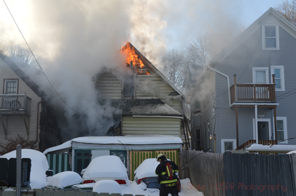 flames from attic of a house