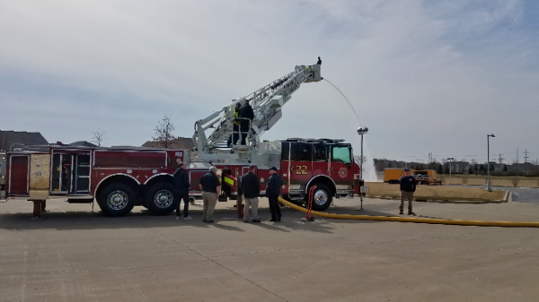 Firefighters training with new tower ladder